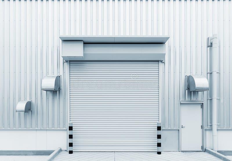 Shutter door factory. Shutter door or roller door and concrete floor outside factory building for industrial background royalty free stock image