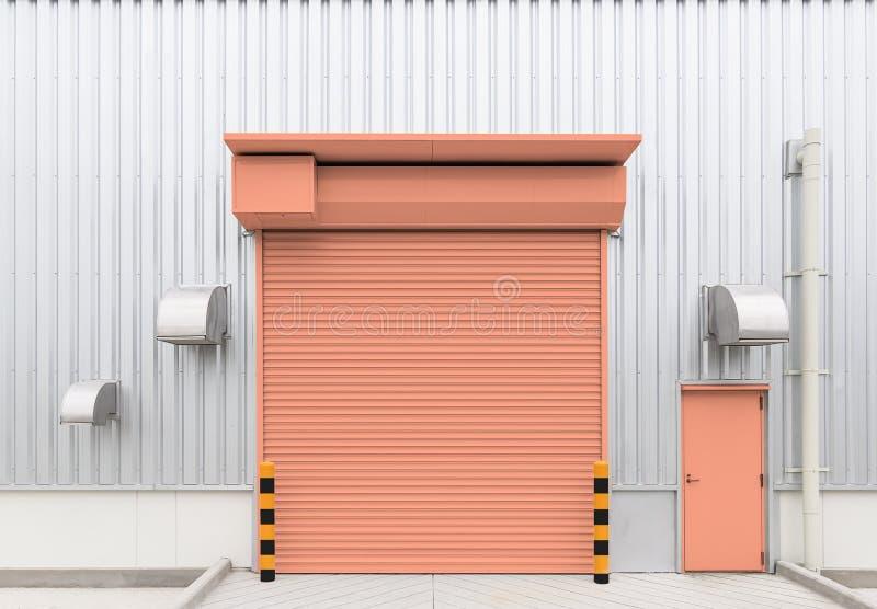 Shutter door factory. Shutter door or roller door and concrete floor outside factory building use for industrial background stock photography