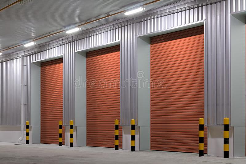 Shutter door night. Shutter door or roller door and concrete floor outside factory building use for industrial background royalty free stock photography