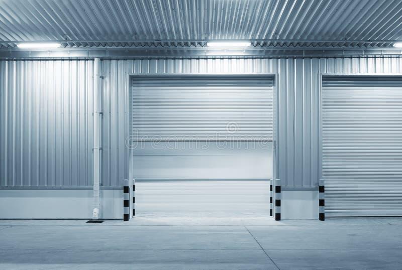 Shutter door night. Shutter door or roller door and concrete floor outside factory building use for industrial background stock photos