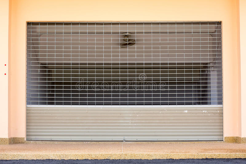 Shutter door. Shutter door or roller door and concrete floor outside factory building use for industrial background royalty free stock photography