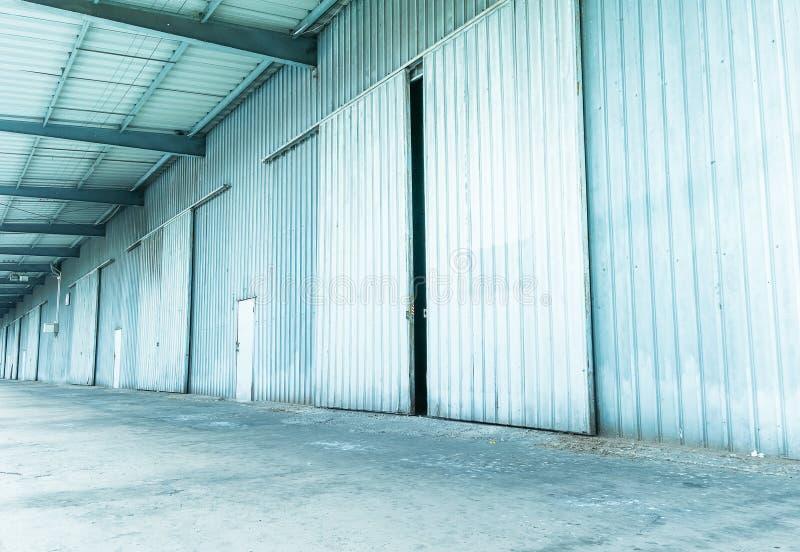 Shutter door or roller door and concrete floor. Outside factory royalty free stock photo
