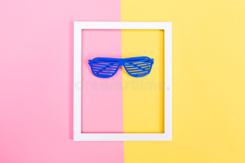 Shutter shades sunglasses on a vibrant background royalty free stock photo