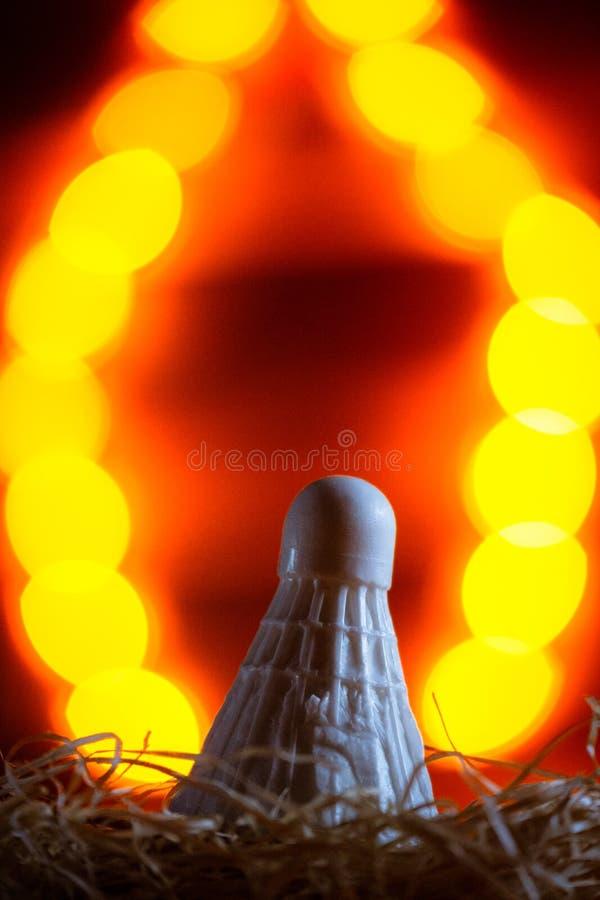 Shuttercock do badminton no fundo do ano novo do bokeh foto de stock royalty free