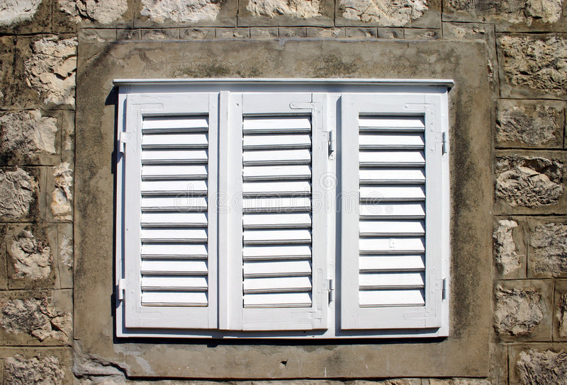 A shuttered window royalty free stock photos