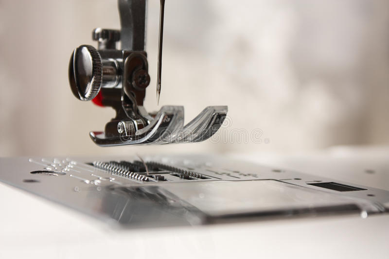 Shuttle close-up of a needle in a sewing machine royalty free stock photos