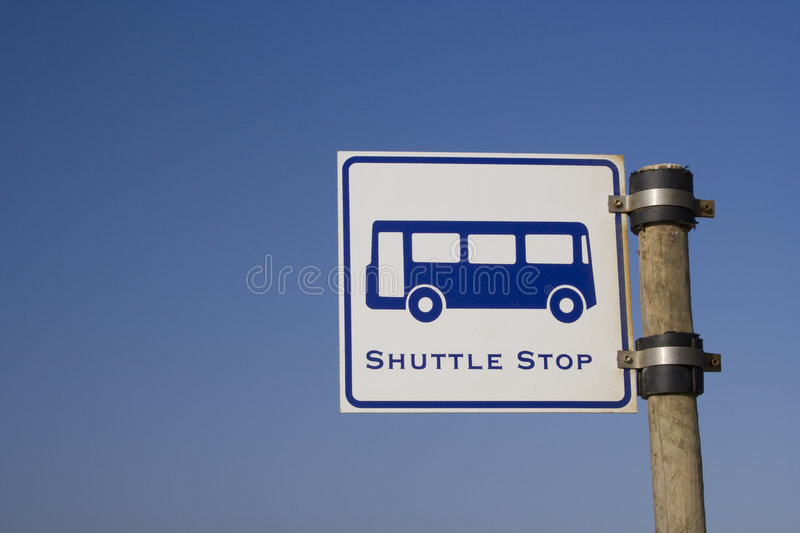 Shuttle stop. A shuttle stop sign over a blue sky royalty free stock photo