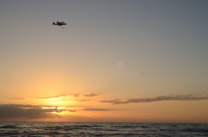 Shuttle Sunrise. Sunrise Shuttle and 747 over Atlantic Ocean Florida royalty free stock image