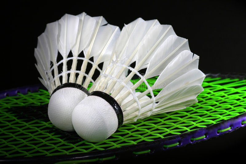 Shuttlecock and badminton stock image