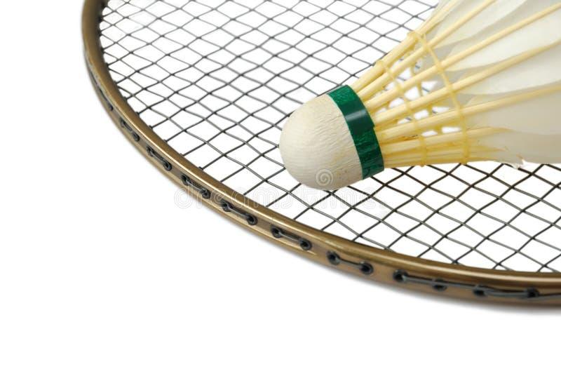 Shuttlecock on badminton racket royalty free stock photo