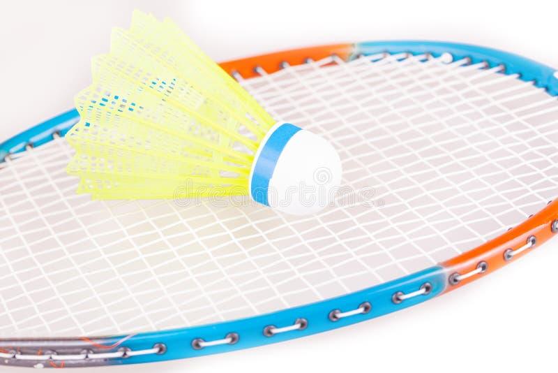 The Shuttlecock on badminton racket closeup. The new Shuttlecock on badminton racket closeup stock photos