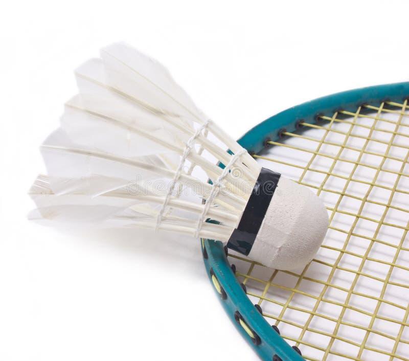 Shuttlecock with badminton racket. Shuttlecock with badminton racket on white background stock photography