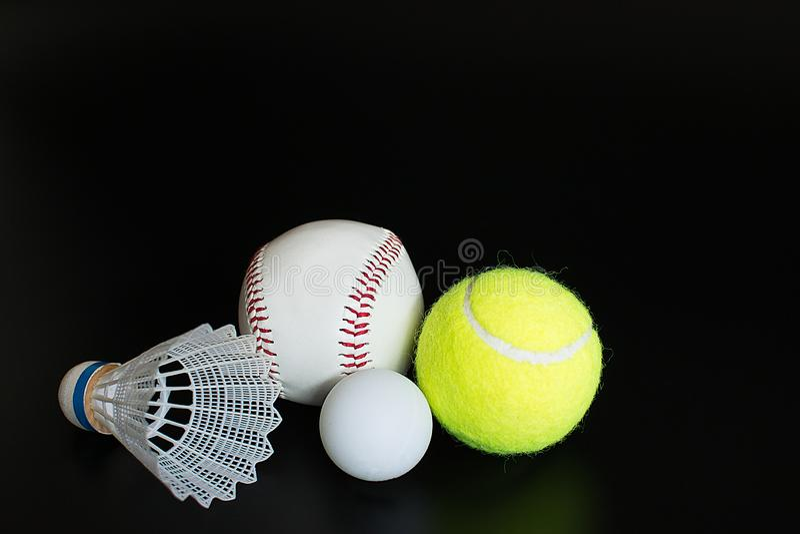 Shuttlecock, ping pong ball, baseball, tennis ball on black background. Shuttlecock ping pong ball baseball tennis ball on black background stock images