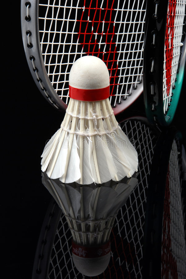 Shuttlecock and rackets. Badminton rackets and shuttlecock, Focus is on the shuttlecock royalty free stock images