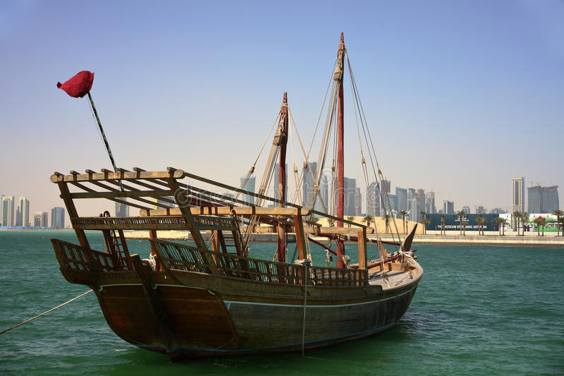 Shuwa'i dhow in Doha bay. A Qatari shuwa'i dhow, of the kind used for inshore fishing and pearling, anchored in Doha bay as part of an exhibition of old ships. A stock photo