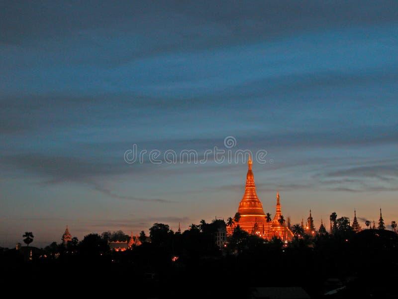Shwedagon Pagoda, Yangon. Gleaming in gold, the huge Shwedagon Pagoda (also Shwe Dagon Pagoda or Shwedagon Paya) in Yangon is a spectacular work of Burmese royalty free stock photography