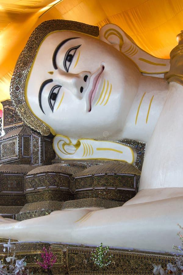 Shwethalyaung Reclining Buddha - Bago - Myanmar. The Shwethalyaung Reclining Buddha in Bago in Myanmar (Burma). The Buddha, which has a length of 55m (180 ft) stock photography