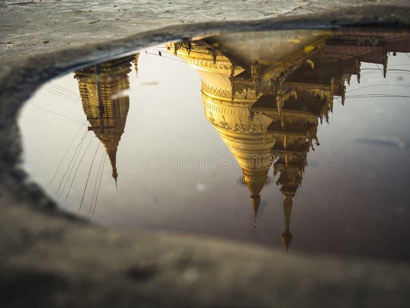 Shwezigon Paya pagoda reflection water surface Landmark Temple historical Architecture Bagan Myanmar. Travel Asia royalty free stock photography