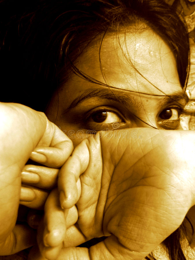 Shy. A beautiful but shy girl hides her face stock photography