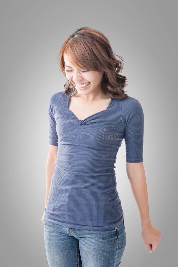 Shy Asian girl smiling. Closeup portrait stock photography