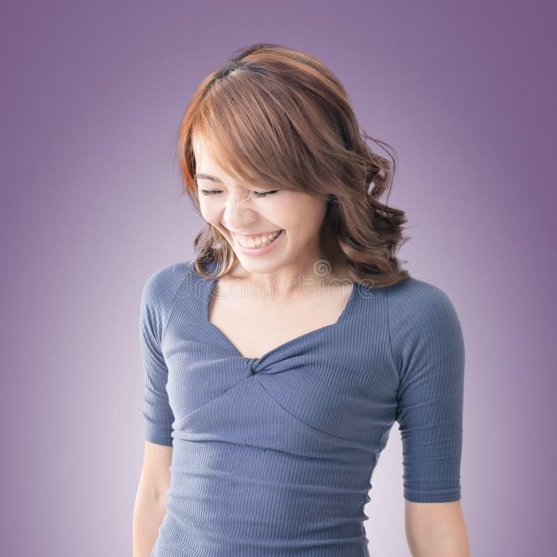 Shy Asian girl smiling. Closeup portrait royalty free stock image