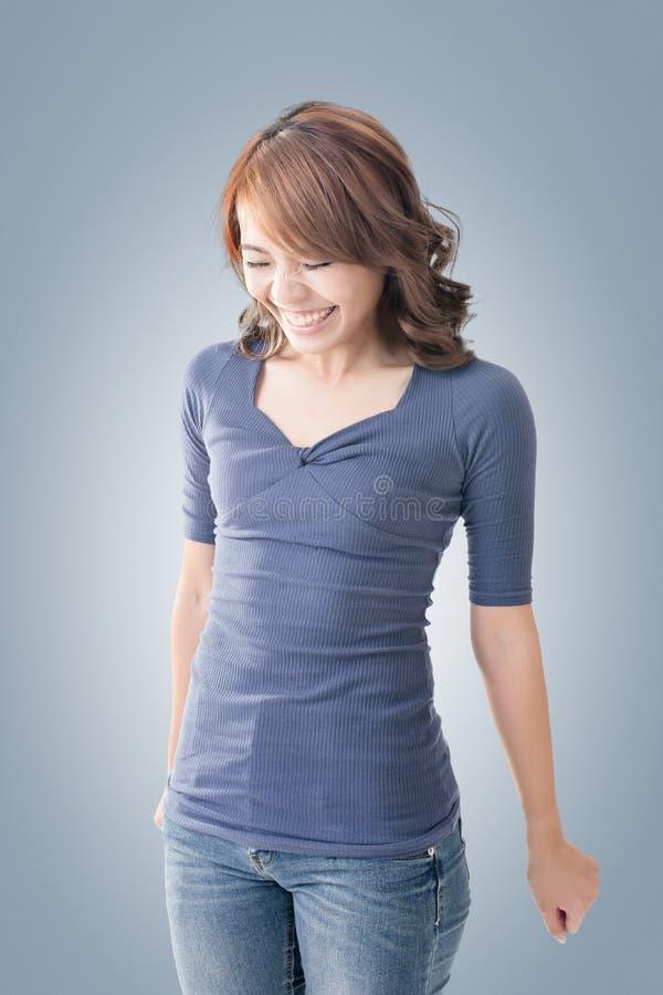 Shy Asian girl smiling. Closeup portrait royalty free stock photo