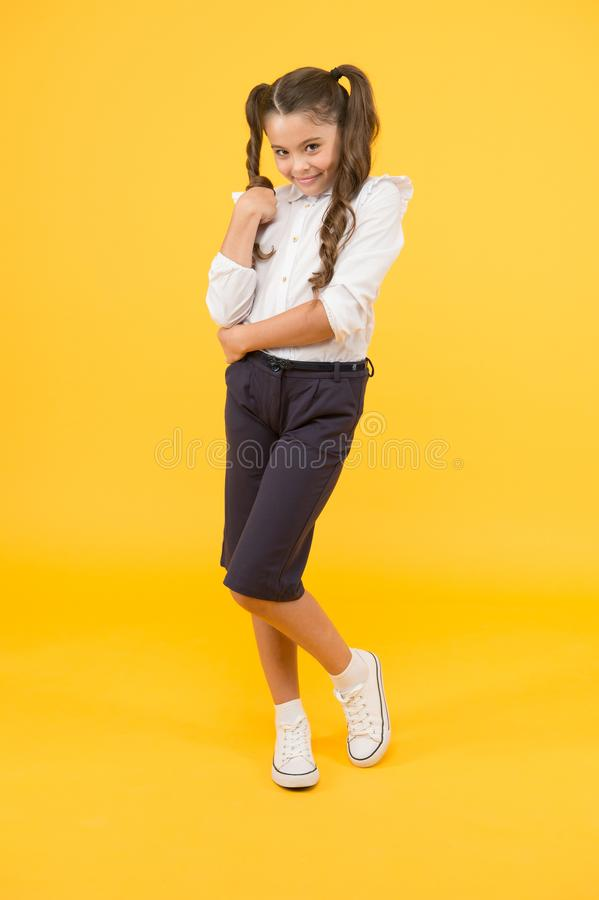 Shy beauty. Modern schoolgirl. Schoolgirl happy smiling pupil long hair. Adorable timid sheepish schoolgirl. Time to. Study. Ready for lesson. School fashion royalty free stock photos