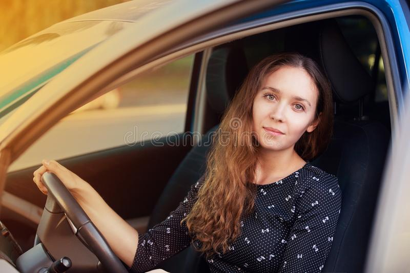 Shy european alone at car garage. Rental insurance jeep. luxury hire service.  stock images