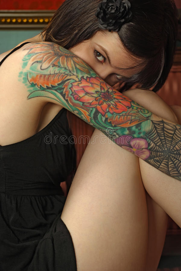 Free Shy Female With Tattoo Royalty Free Stock Photography - 13741567