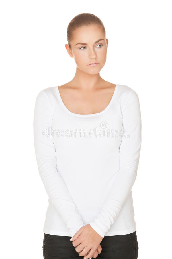 Shy girl. Beautiful shy girl in white t-shirt on isolated white royalty free stock images