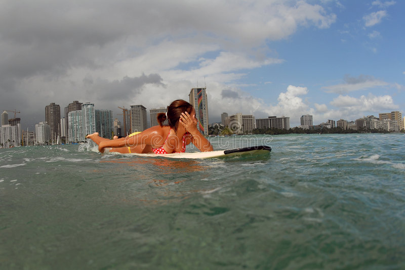 Shy girl surfer stock images