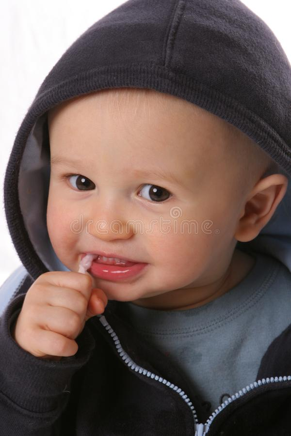 Shy hooded toddler stock images