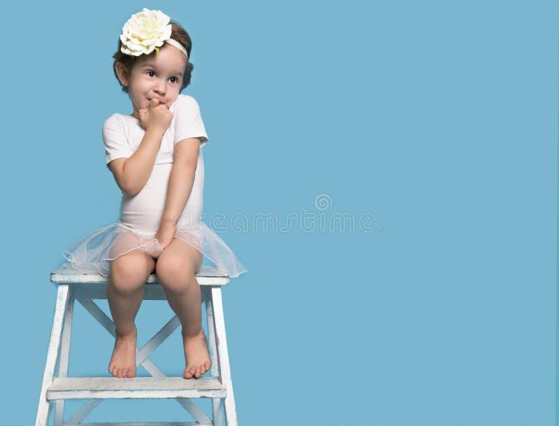 Shy Little Cute Girl in a White Dress stock photos