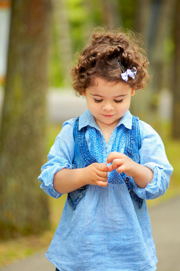 Download Shy little girl stock image. Image of down, girl, outside - 28202139