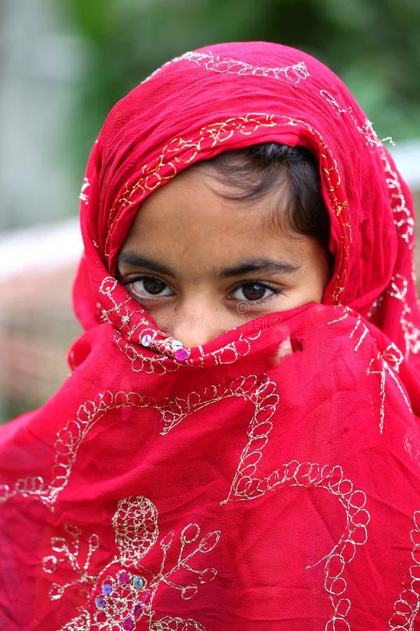 Shy muslim girl. Portrait shot of shy muslim girl royalty free stock photos