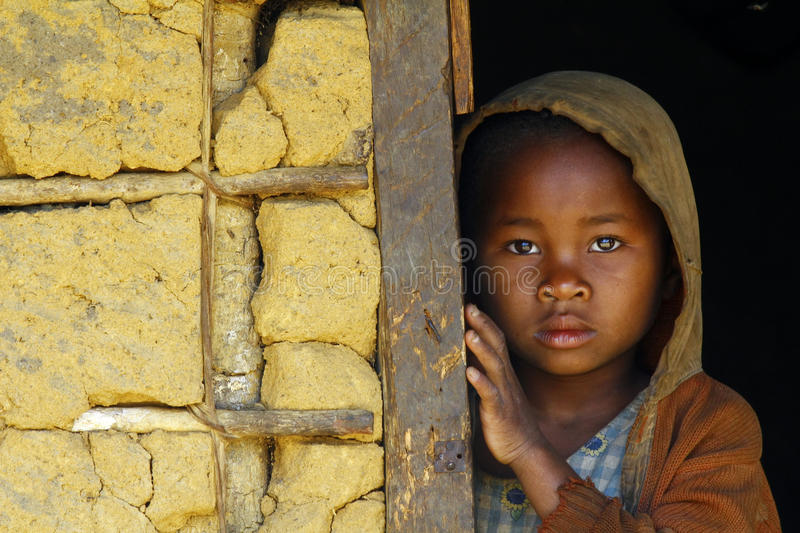Shy and poor african girl with headkerchief. Madagascar-shy and poor african girl with headkerchief stock photos