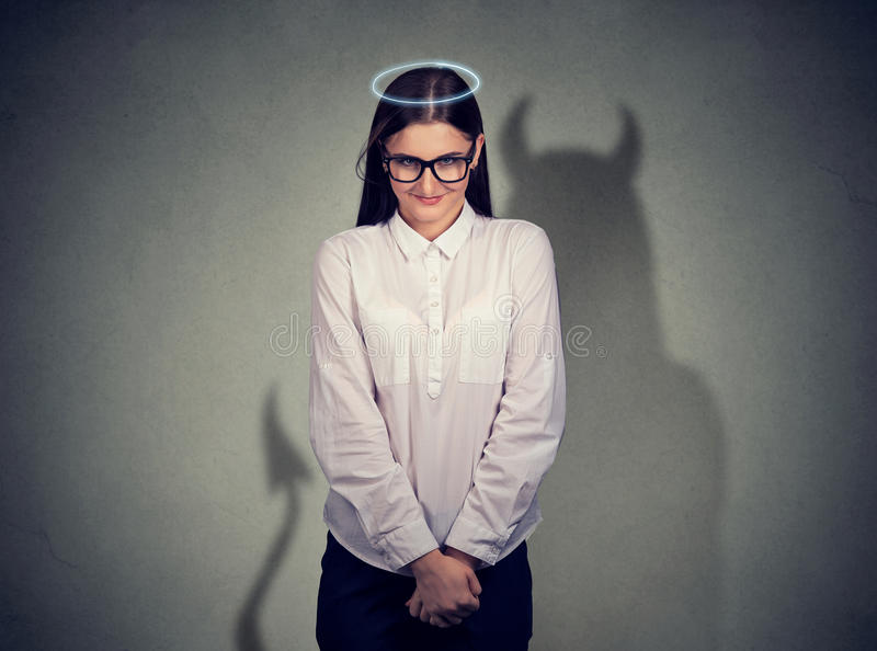 Shy quiet angel woman with devil character stock image