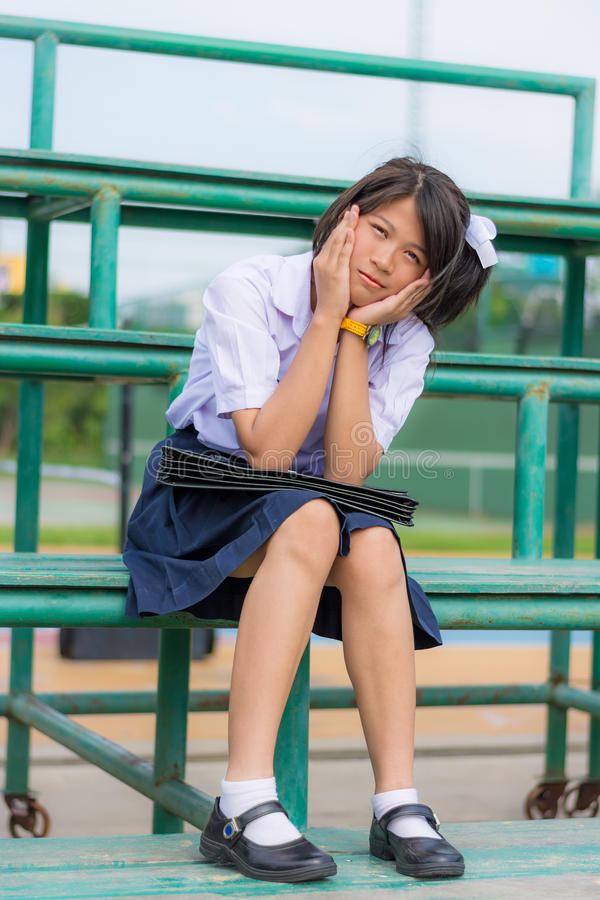 Download Shy Thai Schoolgirl Sitting On A Stand Stock Photo - Image of emotion, outdoor: 30556312