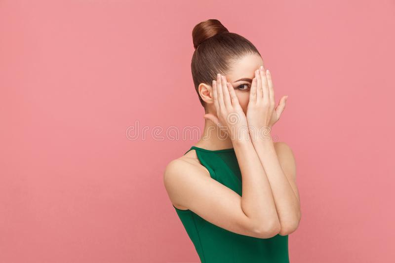 Shy woman closed face hands. Expression emotion and feelings concept. Studio shot, on pink background stock photos