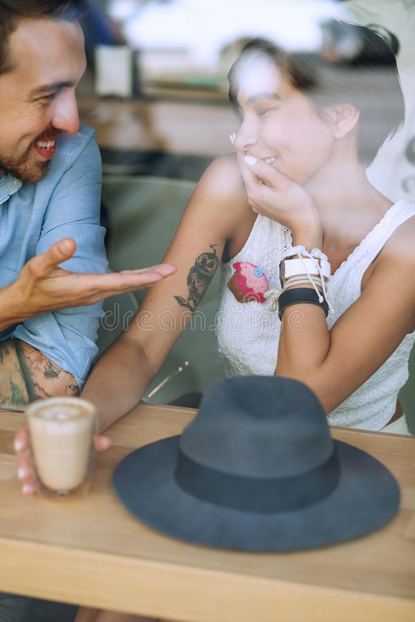 Shy woman and speaking man in cafe royalty free stock image