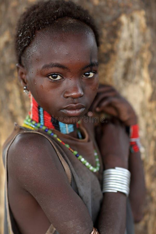 Shy young Hamer girl in South Omo, Ethiopia. Shy young Hamer girl in a traditional village in South Omo, Ethiopia royalty free stock photo