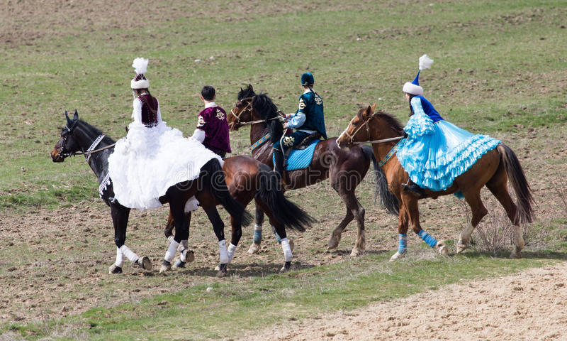Shymkent, KAZAKHSTAN - 22 March 2017: Celebration of the Kazakh holiday NARIYZ. Competitions on horses stock photo