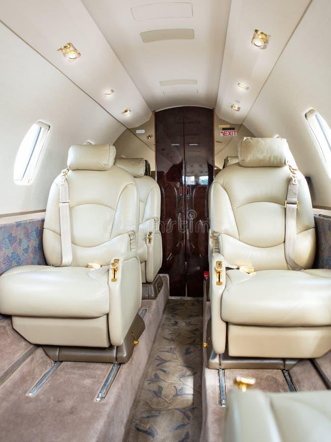 Sièges en cuir sur Jet Airplane image libre de droits