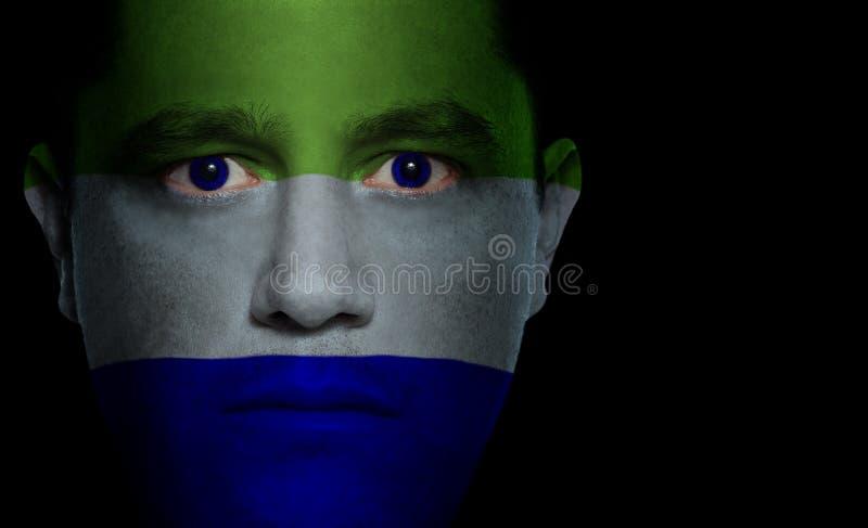 Siërra de Vlag van Leonese - Mannelijk Gezicht stock afbeeldingen