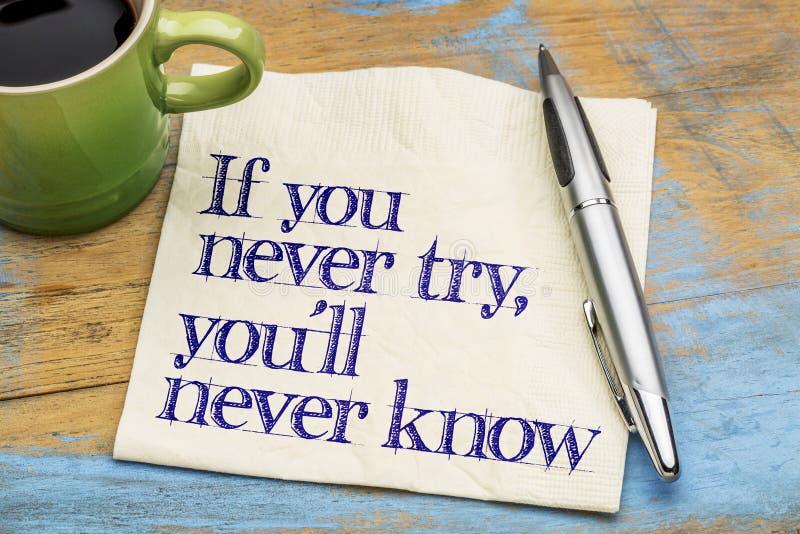 Si usted nunca intenta lema en servilleta foto de archivo