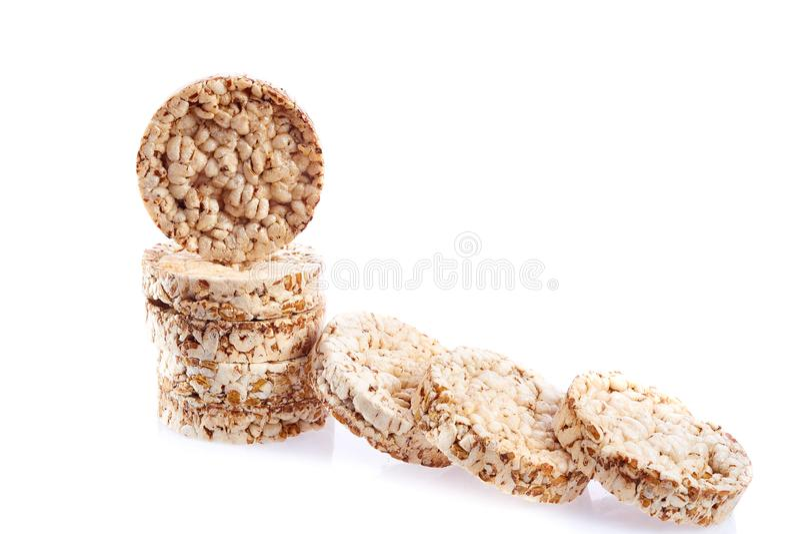 Sia a dieta il mucchio dei dolci di riso isolato su fondo bianco immagini stock libere da diritti