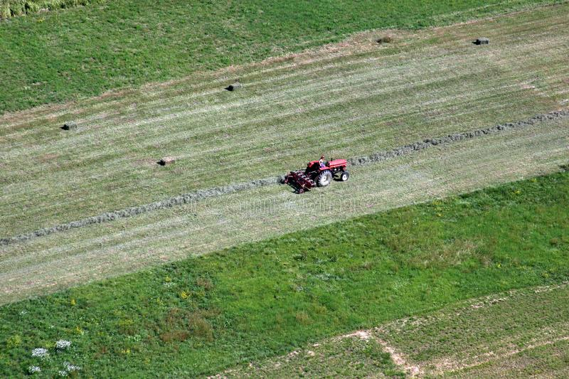 An aerial view of tractor working in a field. In Sisljavic Croatia royalty free stock photo
