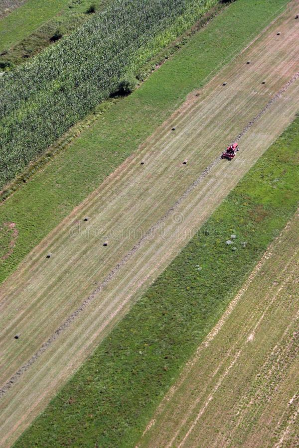 An aerial view of tractor working in a field. In Sisljavic Croatia royalty free stock images