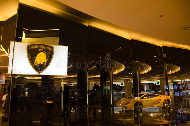 The Yellow super car lamborghini in show room of the 2sn floor at center of siam paragon pride of bangkok Thailand. royalty free stock image