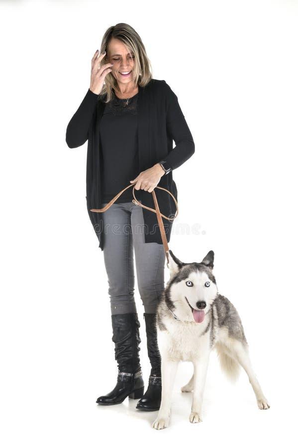 Siberian husky and woman royalty free stock photo